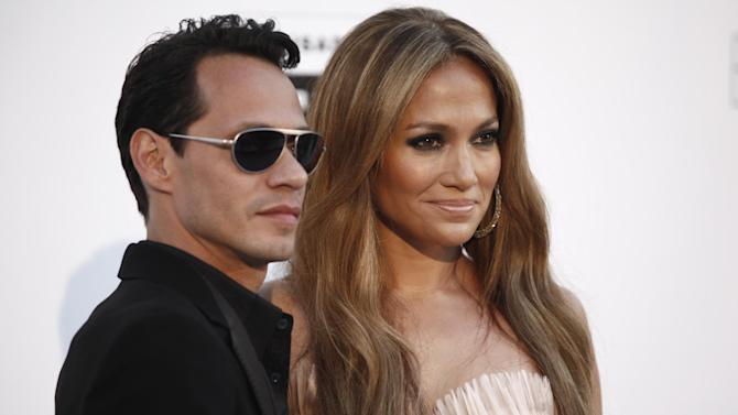 FILE  - In a May 20, 2010 file photo, singers Marc Anthony and Jennifer Lopez arrive for the amfAR Cinema Against AIDS benefit during the 63rd Cannes international film festival, in Cap d'Antibes, southern France. Marc Anthony has made his breakup from Lopez official by filing for divorce in Los Angeles. The singer filed his petition to end the marriage on Monday, April 9, 2012, and cited irreconcilable differences. (AP Photo/Matt Sayles, File)