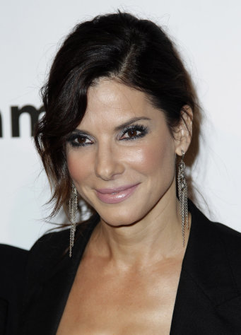 FILE - In this Oct. 27, 2011 file photo, actress Sandra Bullock arrives at amfAR's Inspiration Gala in Los Angeles. Bullock is one of many successful actresses over 40 working in Hollywood. (AP Photo/Matt Sayles, file)