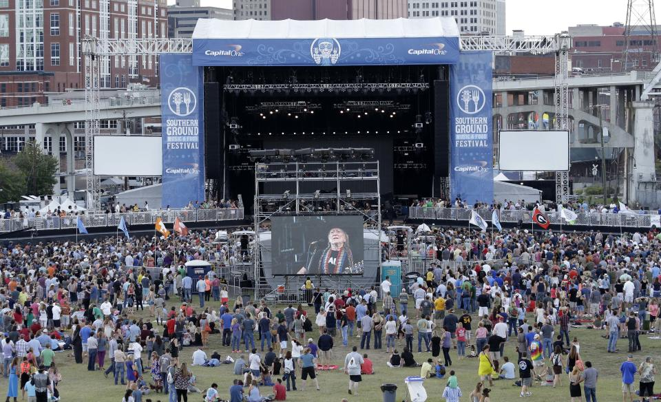 In this Sept, 28, 2013 photo, people attend a Willie Nelson concert at the Southern Ground Music & Food Festival in Nashville, Tenn. Over 25 acts played at the two-day event that showcases Nashville's chefs and restaurants as well as the music. (AP Photo/Mark Humphrey)