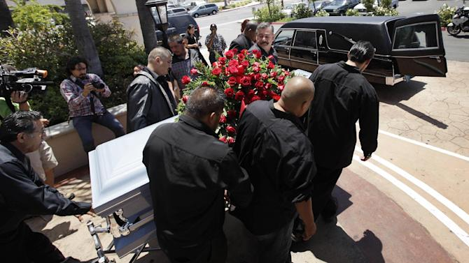 FILE - In this June 19,2010 file photo showing relatives and friends of Anastasio Hernandez carrying a casket out of a church after funeral services in San Diego. Hernandez died May 28 after being shocked by a stun gun during a fight with U.S. Border Patrol agents as they were escorting him to a border gate to return him to Mexico. The mother of Hernandez who died after U.S. border authorities shot him with a stun gun plans to leave for Washington to demand answers in a federal investigation that has lasted nearly two years. Her trip comes after a new video surfaced showing the incident. (AP Photo/Gregory Bull,File)