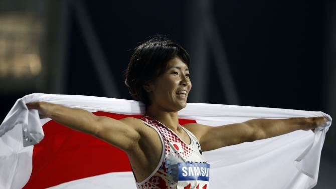 Japan's Satomi Kubokura celebrates finishing second in the women's 400m hurdles final at the Incheon Asiad Main Stadium during the 17th Asian Games