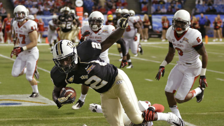 Central Florida wide receiver Jeff Godfrey (2) is tripped up by Ball State safety J.C. Wade (27) during the first quarter of the Beef 'O' Brady's Bowl NCAA college football game Friday, Dec. 21, 2012, in St Petersburg, Fla. (AP Photo/Chris O'Meara)
