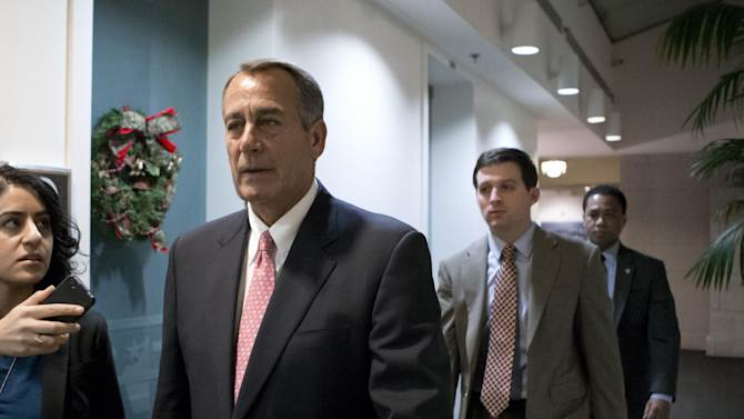 """Speaker of the House John Boehner, R-Ohio, walks to a closed-door GOP caucus as Congress meets to negotiate a legislative path to avoid the so-called """"fiscal cliff"""" of automatic tax increases and deep spending cuts that could kick in Jan. 1., at the Capitol in Washington, Sunday, Dec. 30, 2012. (AP Photo/J. Scott Applewhite)"""