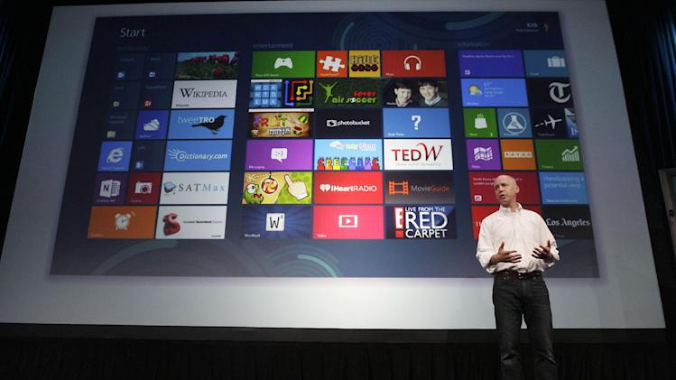 Kirk Koenigbauer, Corporate Vice President of Microsoft Office Division, speaks at a Microsoft event in San Francisco, Monday, July 16, 2012. Microsoft unveiled a new version of its widely used, lucrative suite of word processing, spreadsheet and email programs Monday, one designed specifically with tablet computers and Internet-based storage in mind. (AP Photo/Jeff Chiu)