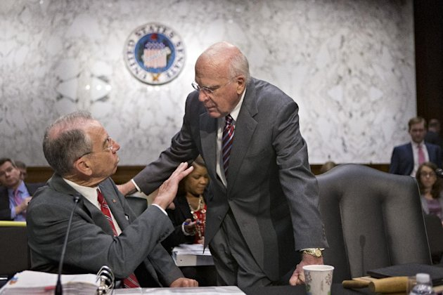 Senate Judiciary Committee Chairman Sen. Patrick Leahy, D-Vt., right, confers with the committee's ranking Republican, Sen. Chuck Grassley, R-Iowa, on Capitol Hill in Washington, Monday, May 20, 2013,