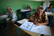 Roma people attend a class in a school of Berkovitsa in August 2012. More than 7,000 people signed up for a new European Union-funded summer programme aimed at combating illiteracy in Bulgaria, a problem disproportionately affecting the Roma minority