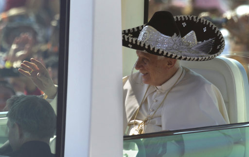Pope Benedict XVI waves from the popemobile wearing a Mexican sombrero as he arrives to give a Mass in Bicentennial Park near Silao, Mexico, Sunday, March 25, 2012. (AP Photo/Eduardo Verdugo)