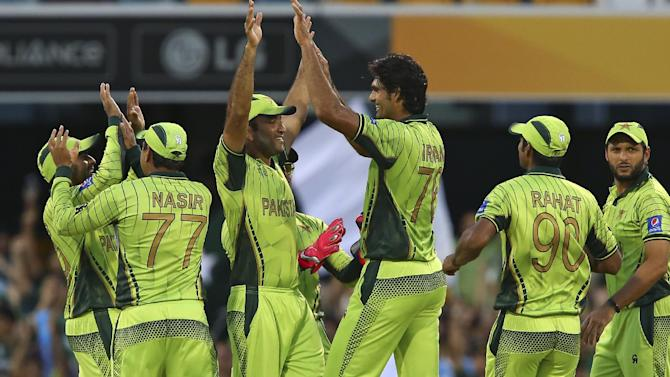 Pakistan players celebrate with wicket of Zimbabwe's Chamunorwa Chibhabha during the Pool B Cricket World Cup match  in Brisbane, Australia, Sunday, March 1, 2015. (AP Photo/Tertius Pickard)