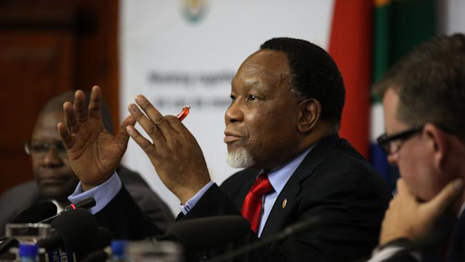 "South Africa's Deputy President Kgalema Motlanthe speaks to foreign journalists at the Union Buildings in Pretoria, South Africa, on Friday, Nov. 30, 2012. Motlanthe says he is ""agonizing"" over whether he would accept leading the governing African National Congress if he's chosen during the party's convention next month over President Jacob Zuma. Some local ANC groups have nominated Motlanthe to take over leadership of the ANC. Typically, whoever leads the ANC becomes the party's presidential candidate. Elections are slated for 2014. (AP Photo/Jon Gambrell)"