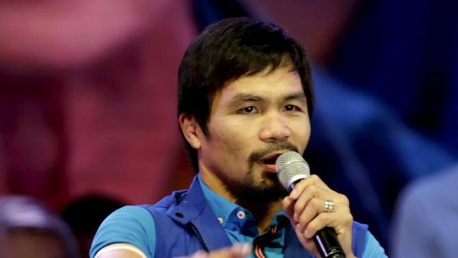 Filipino boxer Manny Pacquiao, who is running for Senator in the May 2016 vice-presidential election, speaks to supporters during the start of national elections campaigning in Mandaluyong city, Metro Manila