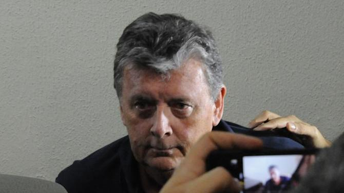 The CEO of Match Hospitality, a subsidary company of FIFA in charge of World Cup ticket packages, Raymond Whelan sits at a police station in Rio de Janeiro after being arrested on July 7, 2014 in Rio de Janeiro
