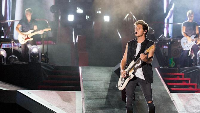 This Aug. 4, 2014 photo released by Columbia Records shows Niall Horan of the British band One Direction performing at MetLife Stadium in East Rutherford, N.J. (AP Photo/Columbia Records , Calvin Aurand)