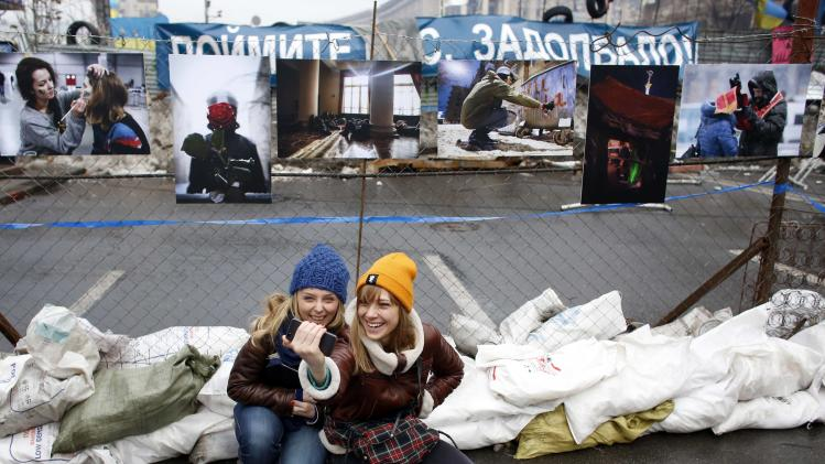 Pro-EU demonstrators take a picture of themselves near a barricade during a rally at Independence Square in central Kiev