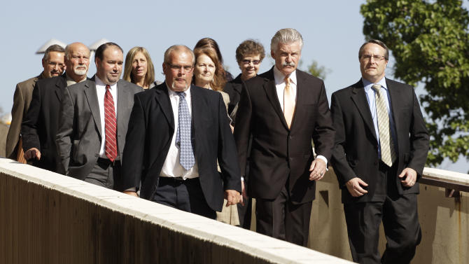 Will County State's Attorney James Glasgow, second from right, leads his prosecution team outside the Will County Courthouse in Joliet, Ill., Thursday, Sept. 6, 2012, after a jury convicted former Bolingbrook, Ill., police officer Drew Peterson of murdering his wife, Kathleen Savio.  Jurors convicted Peterson of murdering his third wife Thursday, capping a sensational, five-year legal saga that began after the swaggering former Illinois police officer's fourth wife vanished. Peterson, 58, faces a maximum 60-year prison term when sentenced. Illinois has no death penalty. (AP Photo/M. Spencer Green)