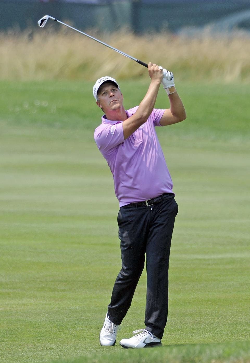 Frederik Jacobsen, of Sweden, watches his approach shot on the ninth hole during the second round of the Travelers Championship golf tournament in Cromwell, Conn., Friday, June 22, 2012. Jacobsen finish with a two-day score of 9-under-par. (AP Photo/Fred Beckham)