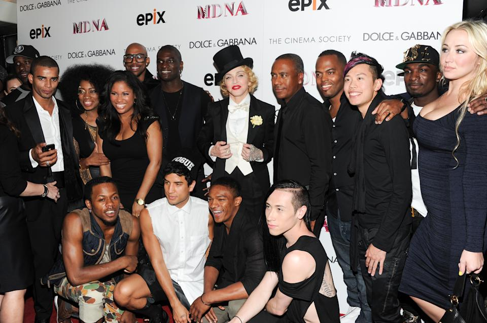 "Madonna poses with her dancers and backing musicians at the world premiere of ""Madonna: The MDNA Tour"" at the Paris Theatre on Tuesday, June 18, 2013 in New York. (Photo by Evan Agostini/Invision/AP)"