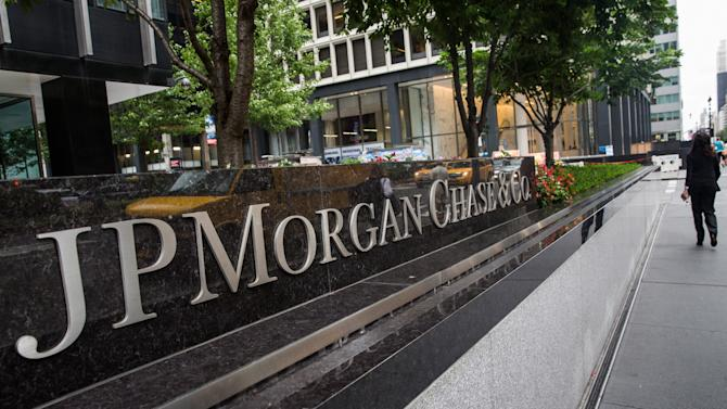 NEW YORK, NY - AUGUST 12: A woman walks past JP Morgan Chase's corporate headquarters on August 12, 2014 in New York City. U.S. banks announced second quarter profits of more than $40 billion, showing strong signs of a recovering economy. (Photo by Andrew Burton/Getty Images)