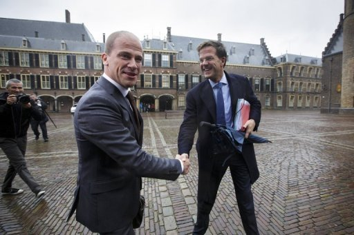 <p>Head of Liberal VVD Mark Rutte (R) and head of the Labour PvdA Diederik Samsom (L) shake hands on October 5 as they arrive at the Senate in the Hague for preliminary negotiations to form a new cabinet. Their two parties said on Sunday that they have agreed to form a coalition.</p>