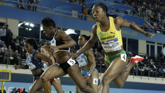 """FILE - This is a Sunday, March 11, 2012 file photo of Jamaica's Veronica Campbell-Brown, right, as she crosses the finish line ahead of Ivory Coast's Murielle Ahoure, left, as Campbell Brown wins the gold medal in the Women's 60m race during the World Indoor Athletics Championships in Istanbul, Turkey. Decorated Jamaican sprinter Veronica Campbell-Brown says she has been cleared to return to the track by an international panel. In a Monday Feb. 24, 2014 statement, the three-time Olympic gold medalist says the Court of Arbitration for Sport has """"confirmed my innocence."""" Campbell-Brown said she is looking forward to returning to competition and is leaving behind """"insensitive and ill-informed media remarks."""" (AP Photo/Matt Dunham/ File)"""