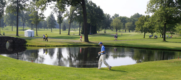 Jim Furyk walks past a lake to the third green during the second round of the Bridgestone Invitational golf tournament at Firestone Country Club, Friday, Aug. 3, 2012, in Akron, Ohio. (AP Photo/Tony D
