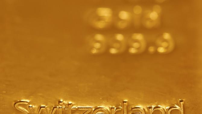 A one kilogramm gold bar imprinted with the word 'Switzerland' is displayed in a Swiss bank in Bern
