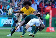 Australia's Radike Samo is tackled by South Africa's Francois Hougaard during a Test match at the Loftus Versfeld stadium in Pretoria. South Africa outplayed injury-plagued Australia 31-8