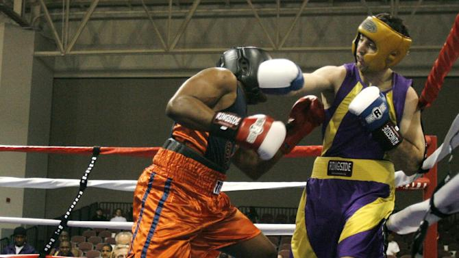 FILE - In this May 4, 2009 file photo,  Tamerlan Tsarnaev, right,  fights Lamar Fenner of Chicago, in the 201 weight class, during the 2009 Golden Gloves National Boxing Tournament at the Salt Palace, Monday, May 4,  2009. Tsameav was identified as a suspect in the Boston Marathon bombings.  Tsarnaev, who had been known to the FBI as Suspect No. 1 and was seen in surveillance footage in a black baseball cap, was killed overnight Thursday during a getaway attempt, officials said. On Friday, April 19, 2013, thousands of officers were swarming the streets in and around Boston hunting for Tsarnaev's younger brother, Dzhokhar Tsarnaev, 19. (AP Photo/The Salt Lake Tribune, Rick Egan)  DESERET NEWS OUT; LOCAL TV OUT; MAGS OUT
