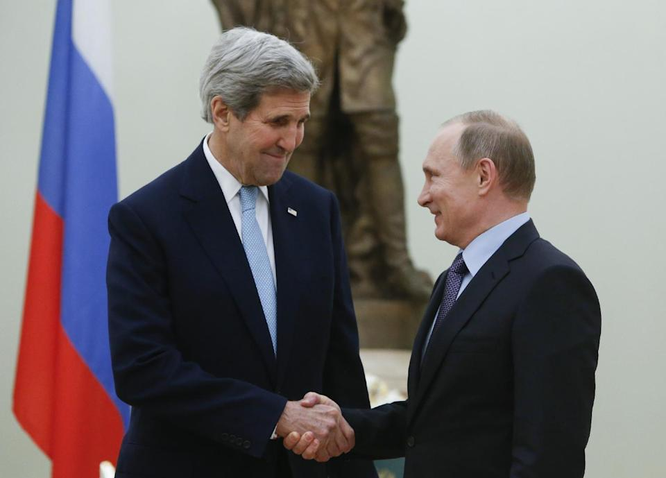 Russian President Vladimir Putin, right, shakes hands with U.S. Secretary of State John Kerry during their meeting in the Kremlin in Moscow, Russia...