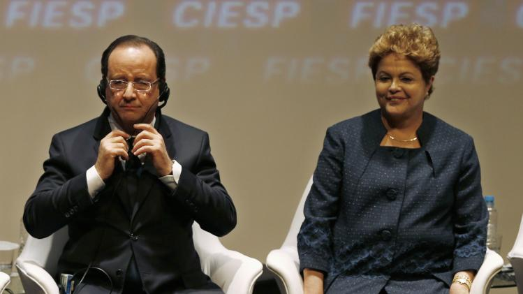 Hollande and Rousseff attend a meeting with businessman at FIESP in Sao Paulo
