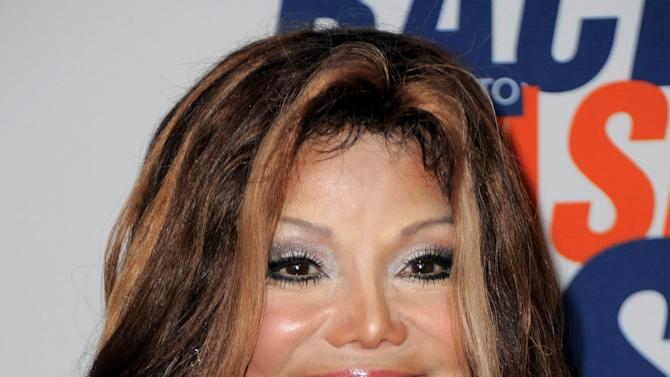 """FILE - This May 18, 2012 file photo shows singer La Toya Jackson arriving at the 19th Annual Race to Erase MS Gala in Los Angeles, Calif. Jackson to star in her own reality show on her TV network, OWN. """"Life with La Toya"""" is described as a """"candid look"""" inside Jackson's life as she juggles family, friends and business. """"Life with La Toya"""" is slated to air in 2013. (Photo by Jordan Strauss/Invision, file)"""
