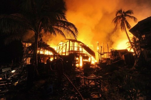 <p>Firemen extinguish a fire engulfing houses in Sittwe, capital of the western state of Rakhine on June 15. Myanmar security forces opened fire on Rohingya Muslims, committed rape and stood by as rival mobs attacked each other during a recent wave of sectarian violence, a rights watchdog said Wednesday.</p>