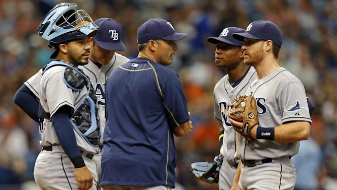 Tampa Bay Rays manager Kevin Cash, center, is surrounded by, from left, Rene Rivera, Evan Longoria, Tim Beckham and Logan Forsythe while making a pitching change during the seventh inning of a baseball game against the Baltimore Orioles, Sunday, May 3, 2015, in St. Petersburg, Fla. (AP Photo/Mike Carlson)