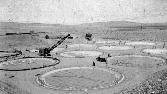 """FILE -- This photo provided by the U.S. Dept. of Energy,  shows the construction of a """"tank farm"""" to store nuclear waste in 1944 on the Hanford nuclear reservation near Richland, Wash. It is one of collection of photos documenting life in and around the reservation from 1943-1967. Six underground radioactive waste tanks at the nation's most contaminated nuclear site are leaking, Gov. Jay Inslee said Friday, Feb. 22, 2013. Inslee made the announcement after meeting with federal officials in Washington, D.C. Last week it was revealed that one of the 177 tanks at south-central Washington's Hanford Nuclear Reservation was leaking liquids. Inslee called the latest news """"disturbing."""" (AP Photo/U.S. Department of Energy, File)"""