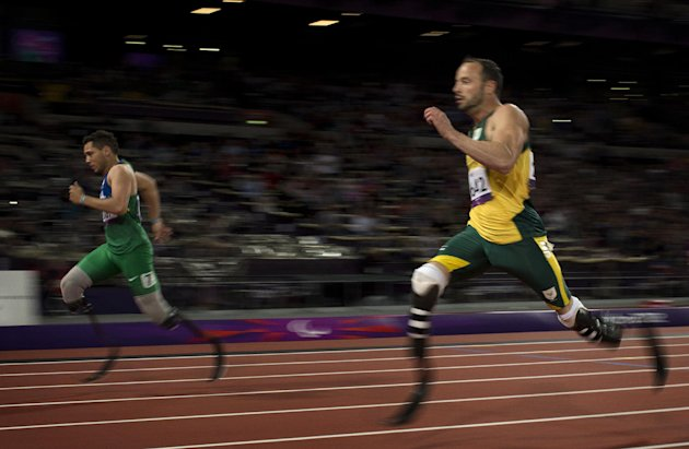 Brazil&#39;s Alan Fonteles Cardoso Oliveira, left, runs in to win the gold medal and beat South Africa&#39;s Oscar Pistorius, right, who took the silver medal in the men&#39;s 200m T44 category final during the athletics competition at the 2012 Paralympics, Sunday, Sept. 2, 2012, in London. (AP Photo/Emilio Morenatti)