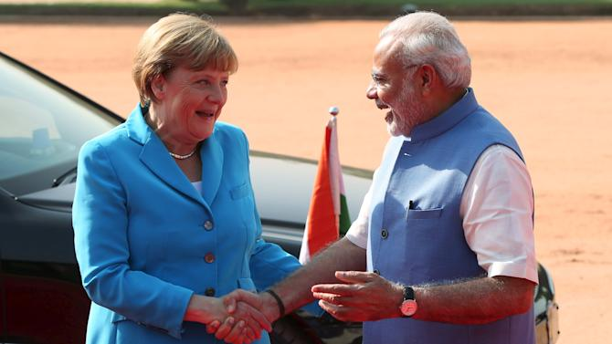 German Chancellor Angela Merkel and Indian Prime Minister Narendra Modi shake hands during Merkel's ceremonial reception at the forecourt of India's Rashtrapati Bhavan presidential palace in New Delhi