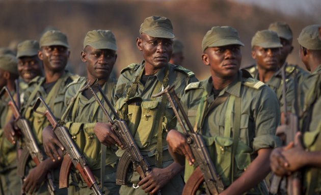 Soldiers from the Republic of Congo, operating under a multinational central-african regional mandate, arrive by airplane to boost existing forces, at an airport in Bangui, Central African Republic Monday, Dec. 31, 2012. Rebels in the Central African Republic on Monday rejected appeals for them to halt their advances and to negotiate to form a coalition government. (AP Photo/Ben Curtis)