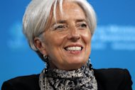 IMF Managing Director Christine Lagarde smiles during a G-20 news conference at the IMF and World Bank Group Spring Meetings in Washington, Friday, April 20, 2012. (AP Photo/Charles Dharapak)