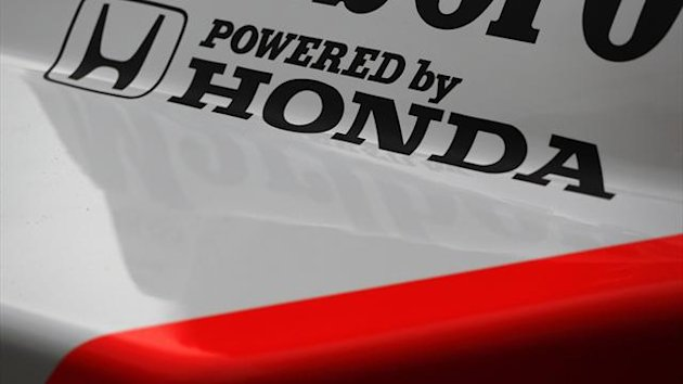 Logo of the Honda Motor Co. is seen on the body of the 1988 McLaren Honda MP4/4 Formula One car at Honda's headquarters in Tokyo May 16, 2013 (Reuters)
