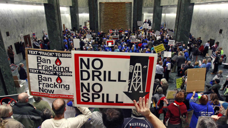 FILE - In this Jan. 23, 2012 file photo, people take part in a rally against hydraulic fracturing of natural gas wells at the Legislative Office Building in Albany, N.Y. In the latest salvo in local battles over gas drilling, a company says it's shutting down wells and stopping free gas to landowners in a western New York town that passed a moratorium on drilling. The town of Avon, 20 miles southwest of Rochester, passed a one-year moratorium on gas drilling and hydraulic fracturing on June 28. Dozens of other towns have enacted similar moratoriums or bans in anticipation of the state completing an environmental review and issuing permits in coming months. (AP Photo/Mike Groll, File)