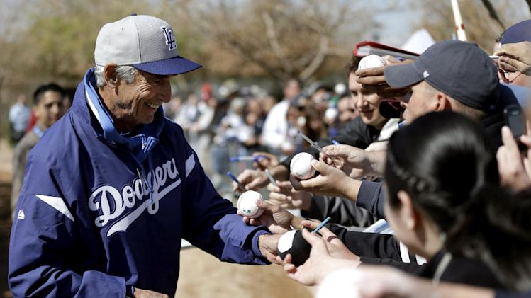 Los Angeles Dodgers Hall of Famer Sandy Koufax signs autographs during spring training baseball in Phoenix, Thursday, Feb. 21, 2013. (AP Photo/Paul Sancya)