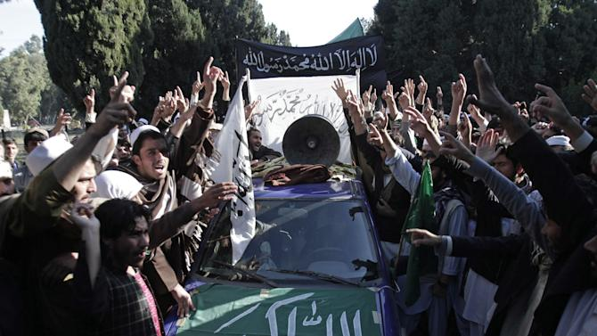 Afghan students of Nangarhar University chant slogans against during a protest against Israeli air strikes in Gaza, in the outskirt of Jalalabad, east of Kabul, Afghanistan, Monday, Nov 26, 2012. (AP Photo/Rahmat Gul)