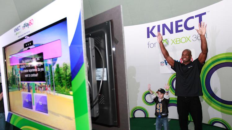 IMAGE DISTRIBUTED FOR XBOX - Young Duke Stein competes against NFL running back Adrian Peterson at Kinect for Xbox 360 on Thursday, Jan. 31, 2013 in New Orleans. (Photo by Barry Brecheisen/Invision for Xbox/AP Images)
