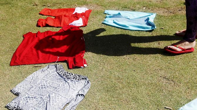 Cuban migrant dries her clothes after arriving safely in La Miel