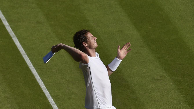 Andy Murray of Britain celebrates after winning his match against Mikhail Kukushkin of Kazakhstan at the Wimbledon Tennis Championships in London