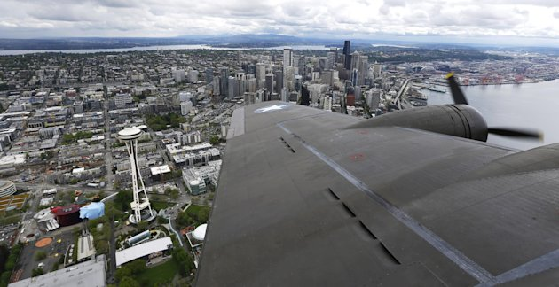 The Space Needle and downtown Seattle are viewed over the wing of a Boeing B-17 (AP Photo/Ted S. Warren)