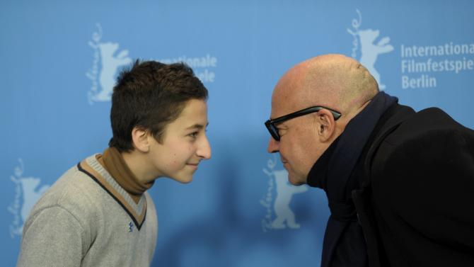 Director Rosi and protagonist Pucillo pose during a photocall to promote the movie 'Fuocoammare' (Fire at Sea) at the 66th Berlinale International Film Festival in Berlin