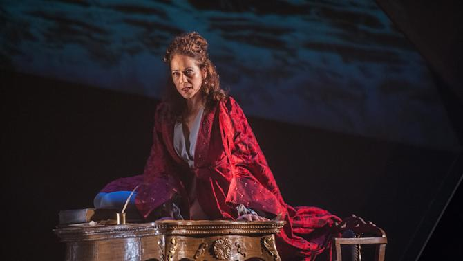 """This July 18, 2012 photo released by the Lincoln Center Festival shows Elizabeth Futral performing a scene from the opera """"Emilie,"""" presented by Lincoln Center Festival 2012 at the Gerald W. Lynch Theater at John Jay  College in New York. (AP Photo/Lincoln Center Theater, Stephanie Berger)"""