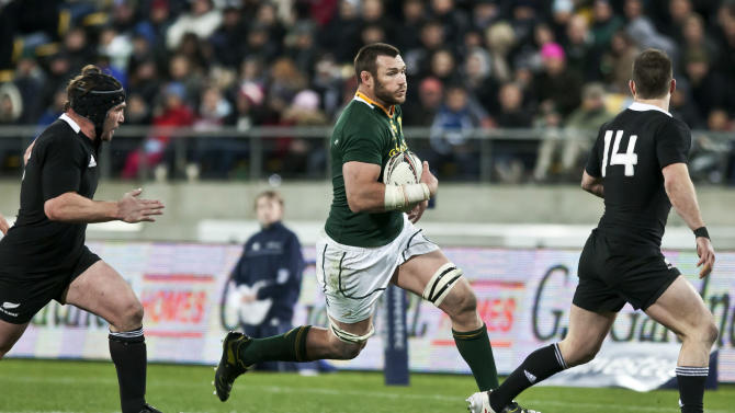 South Africa's Danie Rossouw makes a break during their Tri-Nations rugby match against New Zealand at Westpac Stadium in Wellington, New Zealand, Saturday, July 30, 2011. (AP Photo/NZPA, Aaron Smale) NEW ZEALAND OUT