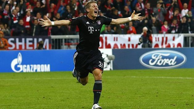 Bayern Munich's Bastian Schweinsteiger celebrates after scoring against Valencia during their Champions League Group F match in Munich  (Reuters)
