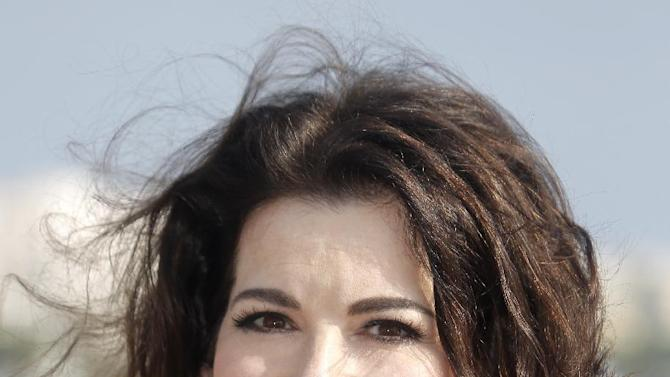 """In this Oct. 9, 2012 file photo, English food writer, journalist and broadcaster, Nigella Lawson poses during the 28th MIPCOM (International Film and Programme Market for Tv, Video,Cable and Satellite) in Cannes, southeastern France. With a new cookbook, """"Nigellissima,"""" coming on the heels of a new celebrity-rich reality food television show on ABC, the English food star seems intent on leaving a larger mark on the American culinary scene. (AP Photo/Lionel Cironneau, File )"""